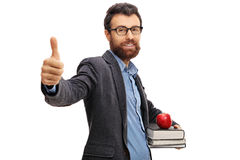 Teacher making a thumb up sign Royalty Free Stock Images