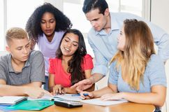 Teacher with male and female students. Indoor at classroom of university Stock Photo