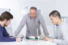 Teacher with male students clas stock images