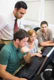 Teacher and mature students in computer room Royalty Free Stock Photo