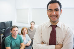 Teacher with mature students in computer room Royalty Free Stock Photos