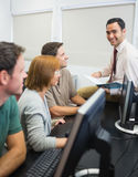 Teacher and mature students in computer room Royalty Free Stock Images