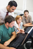 Teacher and mature students in computer room Royalty Free Stock Image