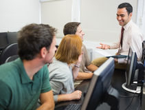 Teacher and mature students in computer room Stock Images
