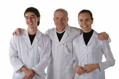 Teacher with medical students. In excellent mood. Isolated on white background Stock Images