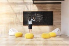 Teacher in modern classroom stock image