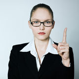 Teacher nanny business woman pointing up finger. Studio shot portrait of one caucasian young  teacher nanny business woman pointing up finger Royalty Free Stock Photo