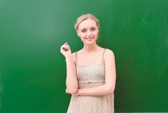 Teacher near blackboard Royalty Free Stock Photos