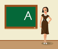 Teacher near the blackboard Royalty Free Stock Images