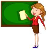 A teacher near the blackboard Stock Photography