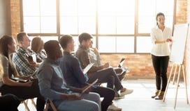 Free Teacher Near Whiteboard Explaining Rules Stock Images - 122724114