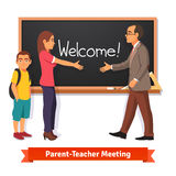 Teacher and parent meeting in classroom Stock Photos