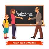 Teacher and parent meeting in classroom Stock Photos