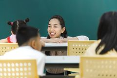 Teacher pay attention at group activities stock photography