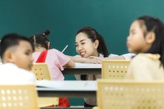 Teacher pay attention at group activities royalty free stock photography