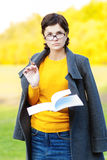 Teacher with pen and writing-book Royalty Free Stock Photo