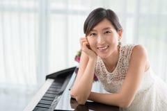 Teacher of piano royalty free stock photo
