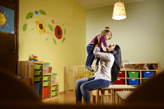 Teacher playing with little girl at school Royalty Free Stock Photography