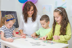 Teacher plays with children Stock Image