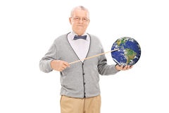 Teacher pointing on the earth with a stick Royalty Free Stock Photos