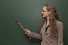 Teacher is pointing to something on the board Royalty Free Stock Photography