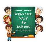 Teacher Points to the Blackboard with Welcome Back Stock Images
