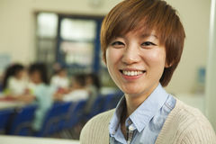 Teacher portrait at lunch in school cafeteria Royalty Free Stock Photo