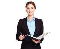 Teacher. Portrait of young businesswoman or a teacher with open book Royalty Free Stock Photos