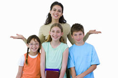 Teacher posing with three pupils, smiling, front view, portrait, cut out Royalty Free Stock Photo