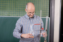Teacher preparing a chemistry experiment Royalty Free Stock Images