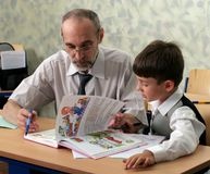 Teacher and pupil. The pupil and the teacher at classroom Royalty Free Stock Image