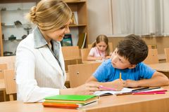 Teacher and pupil Stock Photography