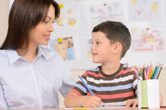Teacher with pupil. Royalty Free Stock Images