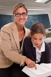Teacher and pupil in class Royalty Free Stock Images