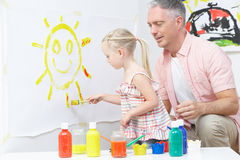 Teacher And Pupil In Pre School Art Class Stock Photo