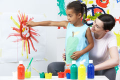 Teacher And Pupil In Pre School Art Class Stock Photography