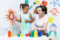 Teacher And Pupil In Pre School Art Class. Painting royalty free stock images