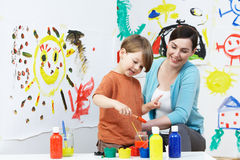 Teacher And Pupil In Pre School Art Class stock images