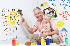Teacher And Pupil In Pre School Art Class Stock Image