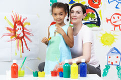 Teacher And Pupil In Pre School Art Class Stock Photos