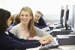 Teacher And Pupil In School Computer Class Royalty Free Stock Photos