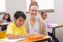 Teacher and pupil smiling at camera Stock Image