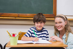 Teacher and pupil smiling at camera Stock Images