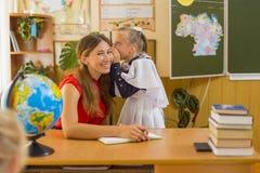 Teacher with pupil Stock Photo