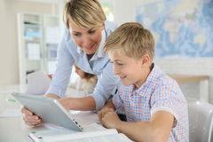 Teacher and pupil with tablet Royalty Free Stock Photos