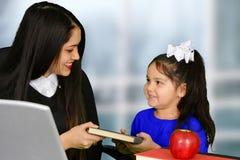Teacher and pupil Stock Photos
