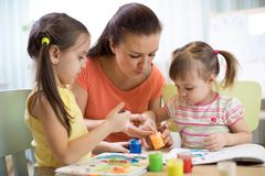 Teacher and pupils in the art workshop Royalty Free Stock Photos