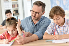 Teacher with pupils in class Royalty Free Stock Photo
