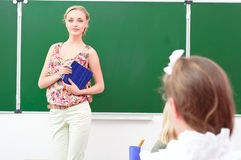 Teacher and pupils in classroom Stock Photos