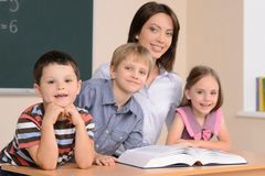 Teacher and pupils. Royalty Free Stock Image